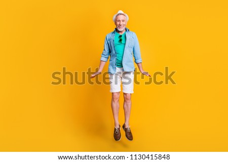Delight rejoice emotion facial expressing enjoy victory concept. Full length size photo portrait of cute handsome lovely glad nice adorable grandpa granddad jumping up isolated bright background