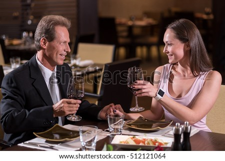 Delighted couple drinking wine in the restaurant