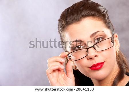 Delightful brunette holds hand glasses.