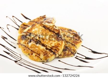 Delightful cheese pancakes on a white background