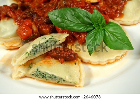 Delightful chicken and spinach ravioli with capsicum, olive and tomato sauce.