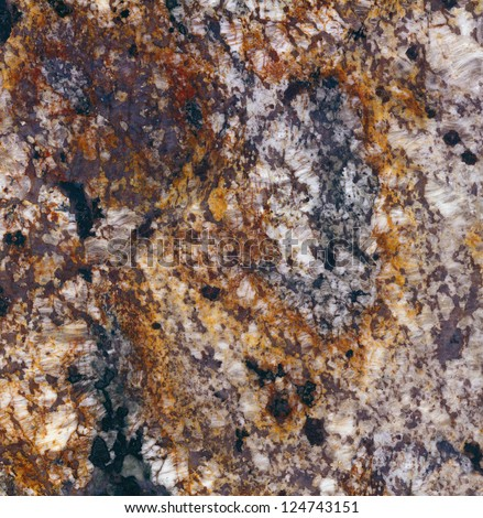 Delirium Granite / Surface of the granite with white, brown, yellow and black tint for background