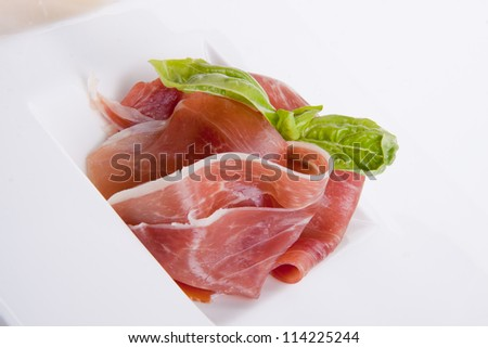 deliscious antipasti plate with parma parmesan and olives isolated on white background