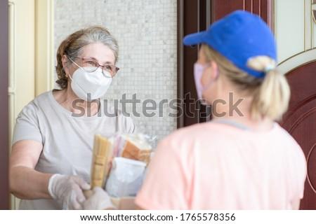 Delivering food to senior woman during quarantine Coronavirus (Covid-19) epidemic