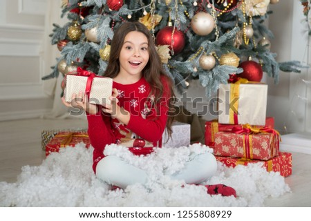 delivery christmas gifts. happy new year. happy little girl celebrate winter holiday. christmas time. Cute little child girl with xmas present. Thank you. Dear santa. #1255808929