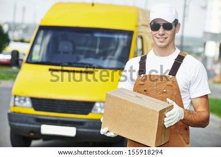 delivery courier man in front of cargo van delivering package parcel carton box