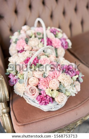 Delivery fresh cut flower from online store. Two Flowers arrangements in Wicker basket. Modern floral shop. Finished work of the florist. #1568753713