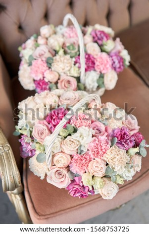 Delivery fresh cut flower from online store. Two Flowers arrangements in Wicker basket. Modern floral shop. Finished work of the florist. #1568753725