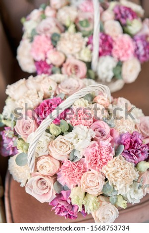 Delivery fresh cut flower from online store. Two Flowers arrangements in Wicker basket. Modern floral shop. Finished work of the florist. #1568753734
