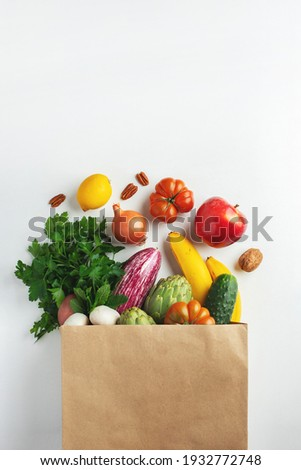 Delivery healthy food background. Healthy vegan vegetarian food in paper bag vegetables and fruits on white, copy space. Shopping food supermarket and clean vegan eating concept