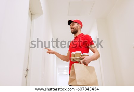 delivery, mail and people concept - happy man delivering coffee and food in disposable paper bag to customer home and ringing doorbell #607845434