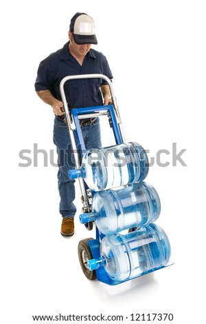 Delivery man bringing five gallon water bottles on a hand truck.  Room for your logo on his hat.  Full body isolated on white.