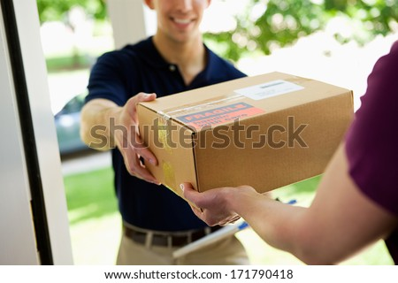 Shutterstock Delivery: Man Delivering Package To Homeowner