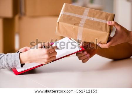 Shutterstock Delivery man delivering parcel box