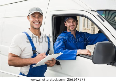 Delivery man getting signature from customer on white background