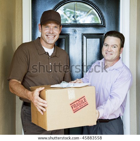 Delivery man hands package to satisfied customer.