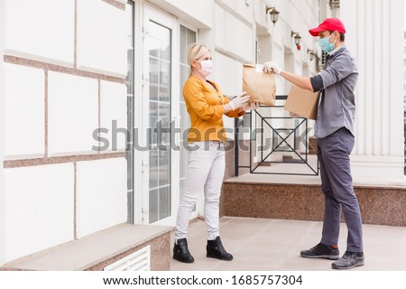 Delivery man holding cardboard boxes in medical rubber gloves. Quarantine. Coronavirus. copy space. Fast and free Delivery transport . Online shopping and Express delivery
