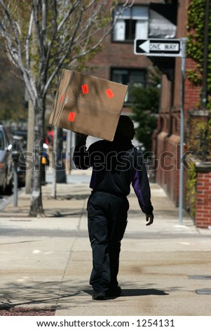 delivery man walking with box on shoulder
