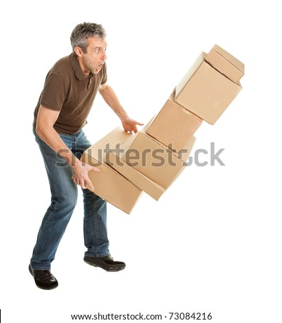 Delivery man with falling stack of boxes