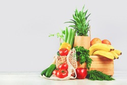 Delivery of grocery. Chest with fresh fruit and vegetables bright green produce. Eco friendly responsible lifestyle and shopping. Healthy eating, zero waste concept. Copy space. Donation.