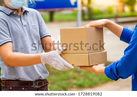 Delivery service for customers during detention during Covid-19. Stock photo ©