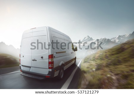 Delivery truck drives on a mountain road #537121279
