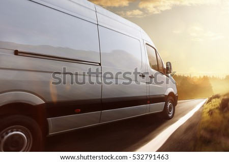 Delivery truck drives on a road