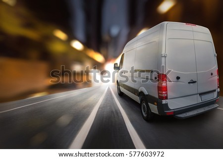 Delivery van at night in a city