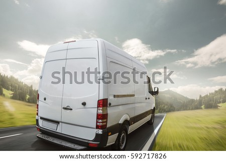 Delivery van drives a day on a country road