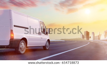 Delivery van driving on road to urban city (3D Rendering)