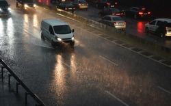 delivery van speeding by highway in rain night