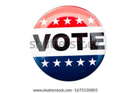 Photo of  Democracy, presidential election and voting poll concept with red, white and blue vote glossy button pin with stars and stripes isolated on white background with clipping path cutout