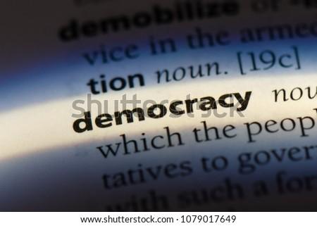democracy word in a dictionary. democracy concept