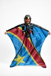 Democratic Republic of the Congo flag travel. Bird Men in wing suit flag. Sky diving men in parashute. Patriotism, men and flag.