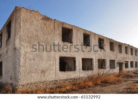 demolished block of flats against blue sky