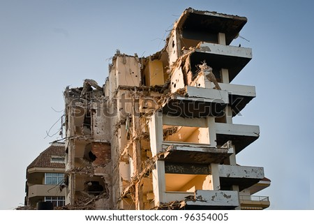 demolished block of flats at sunset