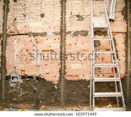 demolition before tiling in kitchen interior construction and ladder