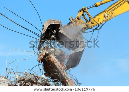 Demolition crane dismantling a building