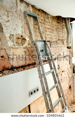 demolition debris in kitchen interior construction and ladder