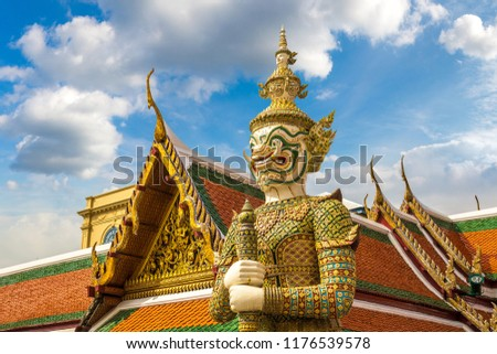 Demon Guardian in Wat Phra Kaew (Temple of the Emerald Buddha), Grand Palace in Bangkok in a summer day