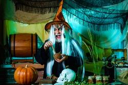 Demon with skull on Halloween party. Halloween art Blood skin man face portrait - close up. Design for Halloween banner. Fantasy horror Halloween