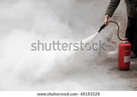 demonstrating how to use a fire extinguisher
