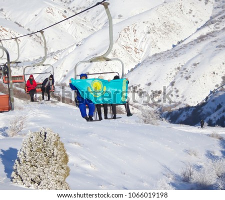Demonstration of the flag of Kazakhstan in the mountains. #1066019198