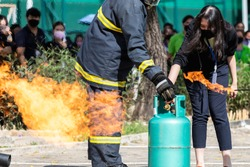 Demonstration of turning off the gas and extinguishing the fire from the gas tank to quench the fire in the real annual rehearsal fire drill at one office in Thailand