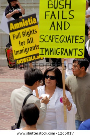 Demonstrator with sign at Los Angeles illegal emigrant rally. May 1st 2006
