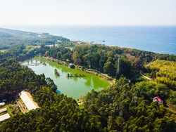 Dendrological aerial view with green lake and blue  black sea in the background.2020