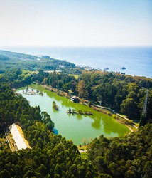 Dendrological aerial view with green lake and blue  black sea in the background.2020 vertical blank space image
