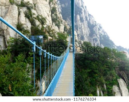 Dengfeng,Henan,China.August 16th,2014.San Juan Village suspension bridge in Songshan inside Shaolin Temple dengfeng city henan province China. #1176276334