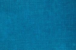 Denim blue color Linen cloth background. Pure linen blue fabric texture. Blue canvas background