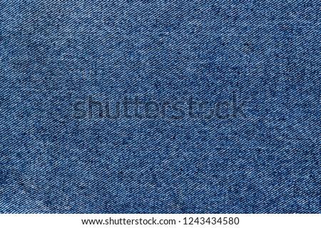 Denim blue jeans fabric texture.  Raw blue denim background. Classic blue Denim jeans cloth